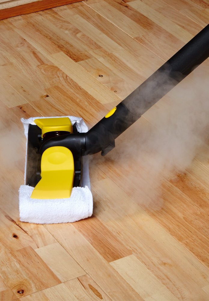 Little yello steam cleaning hardwood floor
